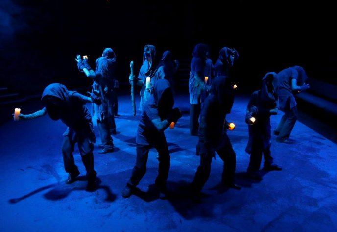 Macbeth witches holding lanterns